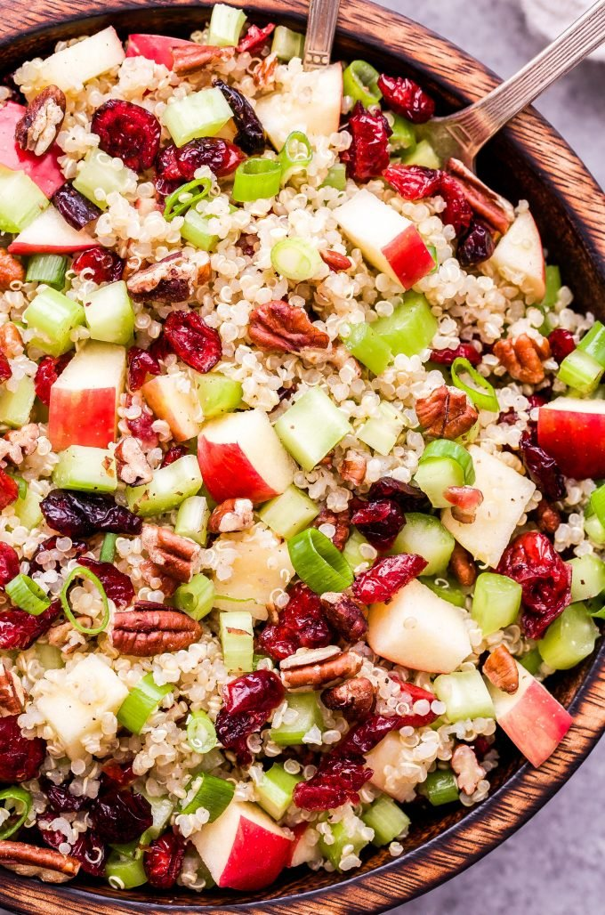 Closeup photo of Cranberry Apple Quinoa Salad in wooden bowl.
