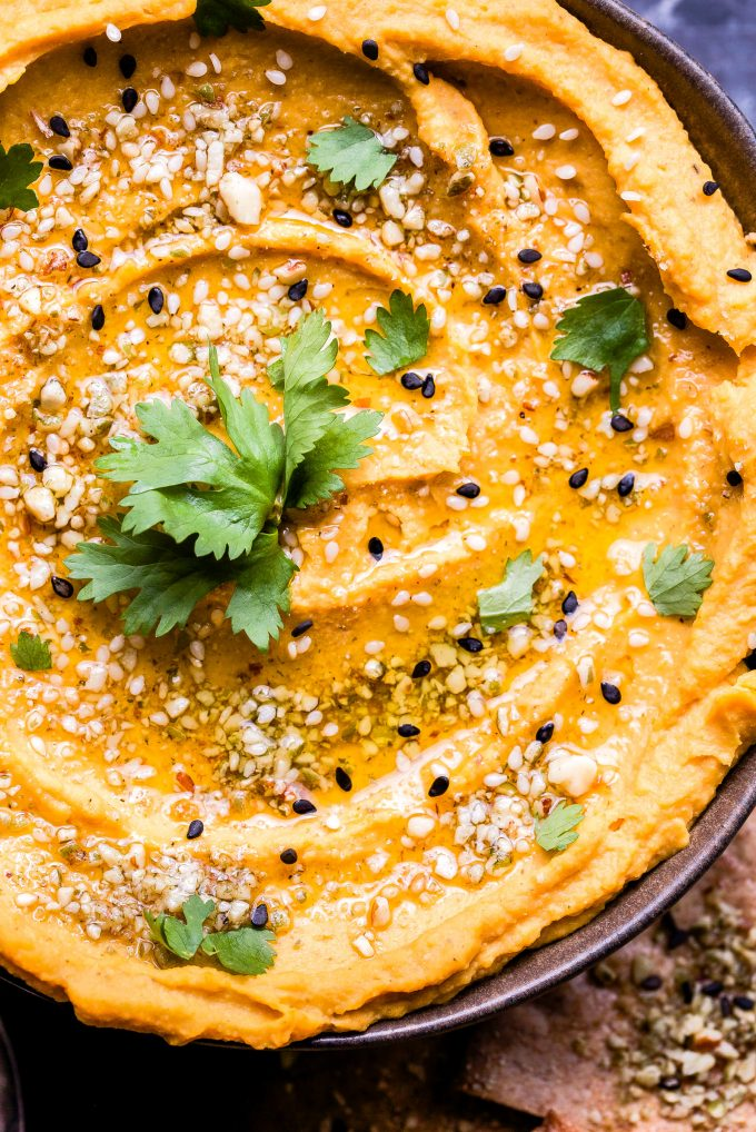Overhead photo of Butternut Squash Hummus topped with dukkah and cilantro.