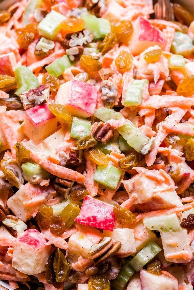 Closeup photo of Carrot Apple Salad with golden raisins, pecans, celery and Yogurt Dressing