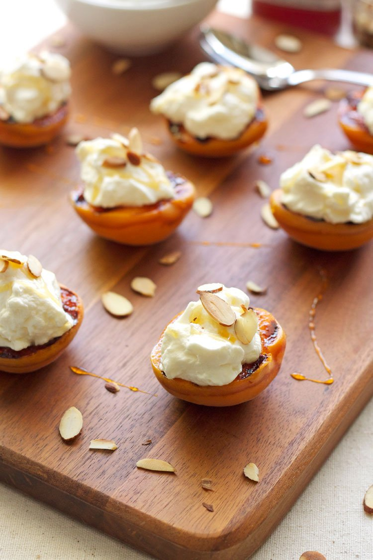 Grilled Apricots with Almond Whipped Cream & Honey | Recipe Runner | Apricots grilled with honey butter topped with almond whipped cream and honey are the perfect #summer dessert!