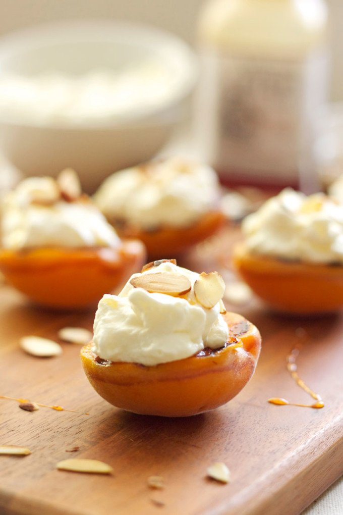 Grilled Apricots with Almond Whipped Cream & Honey | Recipe Runner | Apricots grilled with honey butter topped with almond whipped cream and honey are the perfect summer dessert!