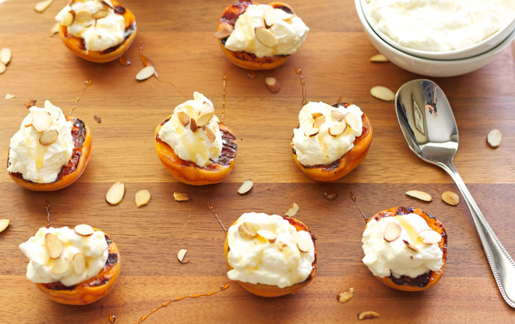 Grilled Apricots with Almond Whipped Cream & Honey   Recipe Runner   Apricots grilled with honey butter topped with almond whipped cream and honey are the perfect #summer dessert!