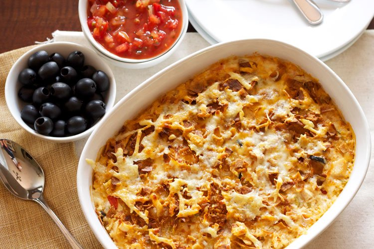 South of the Border Chicken Casserole | Recipe Runner | Cheesy comforting casserole full of chicken, rice, cheese, and green chiles for a little Tex-Mex kick!