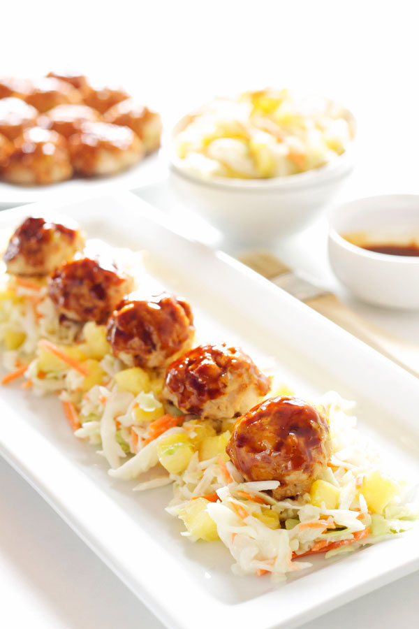 Asian Meatballs with Pineapple Slaw | Recipe Runner | Easy to make Asian inspired meatballs served on top of the most delicious pineapple slaw! #meatballs #appetizer #gamedayeats