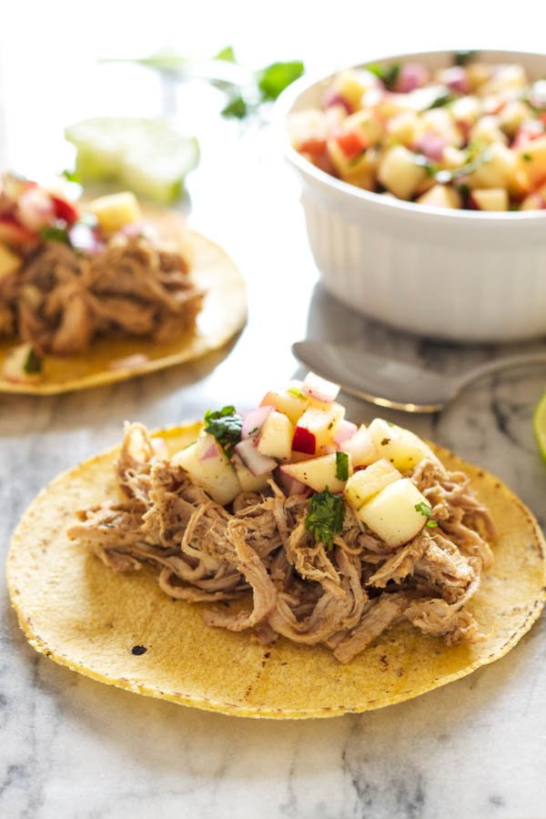 Slow Cooker Carnitas Tacos with Apple Salsa | Recipe Runner | Tender carnitas cooked in the slow cooker and topped with a sweet and spicy apple salsa!
