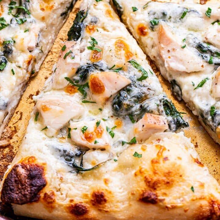 A slice of Chicken Alfredo Pizza