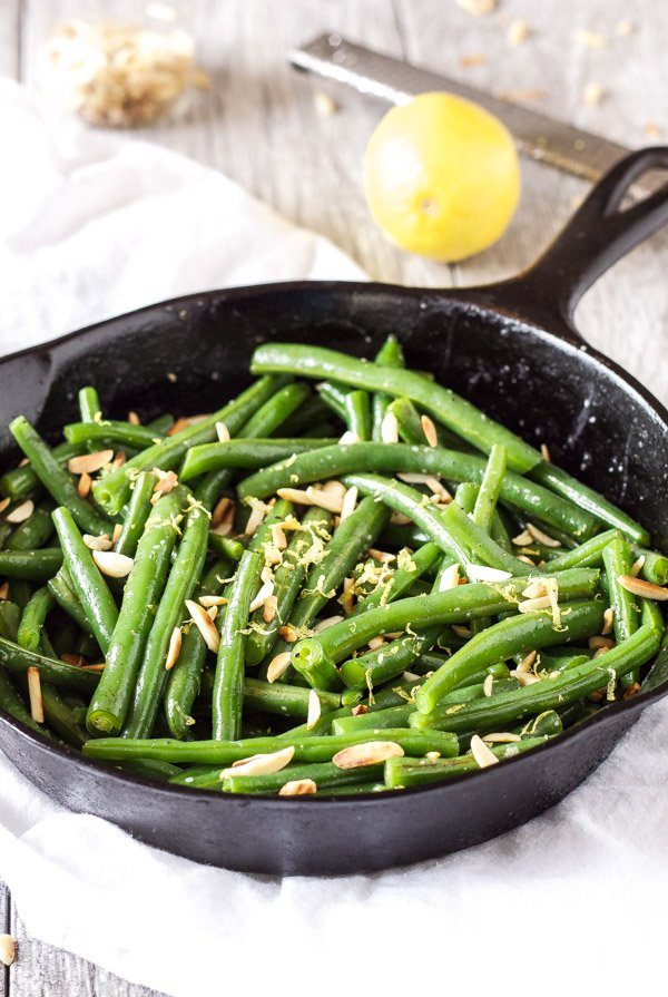 ... green beans covered with brown butter, toasted almonds, and lemon zest