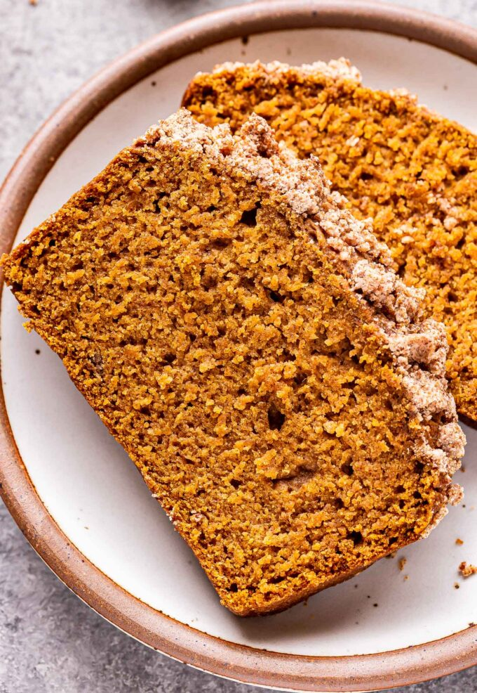 Two slices Vegan Pumpkin Streusel Bread on a white plate