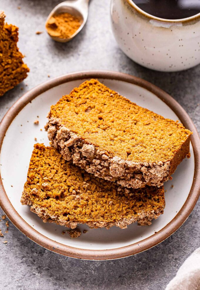 Two slices of Vegan Pumpkin Streusel Bread on a white plate.