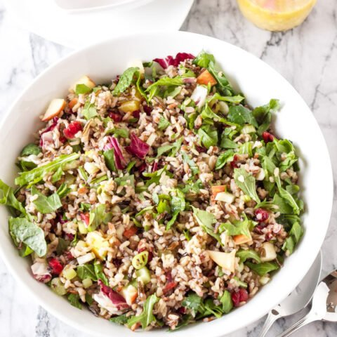 Winter Kale and Wild Rice Salad   www.reciperunner.com   A gorgeous, healthy, and flavorful whole grain salad perfect for serving this holiday season! #vegan #glutenfree