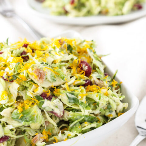 Cranberry Orange Brussels Sprout Slaw   I can't get enough of this sweet tangy winter slaw!   www.reciperunner.com