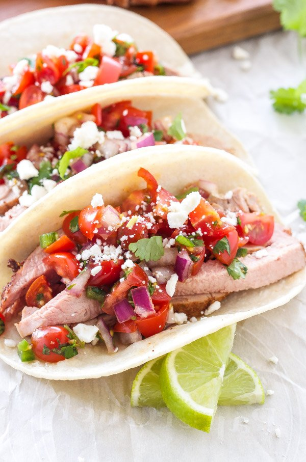 Pork Tenderloin Tacos with Pico de Gallo | Amazing pork tacos topped with the freshest most delicious pico de gallo! | www.reciperunner.com