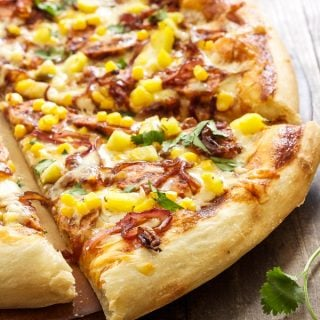 BBQ Chicken Pizza with a slice cut out of it