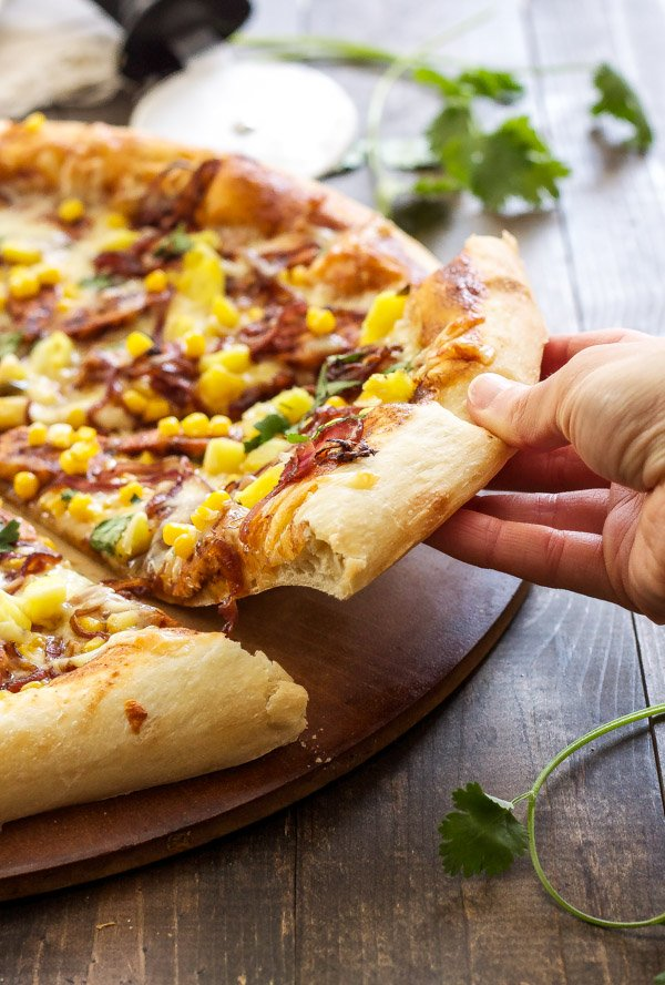 BBQ Chicken Pizza | My favorite pizza loaded with BBQ chicken, pineapple, corn, and caramelized onions! | @reciperunner