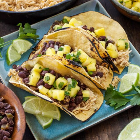 Cuban Chicken and Black Bean Tacos with Pineapple Salsa   Flavorful slow cooker chicken topped with Cuban black beans and fresh pineapple salsa!   @reciperunner