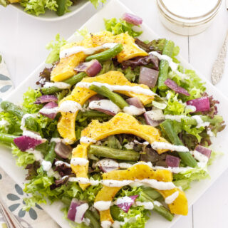 Roasted Squash and Green Bean Salad | Mixed greens topped with roasted vegetables and a creamy Greek yogurt dressing! | www.reciperunner.com