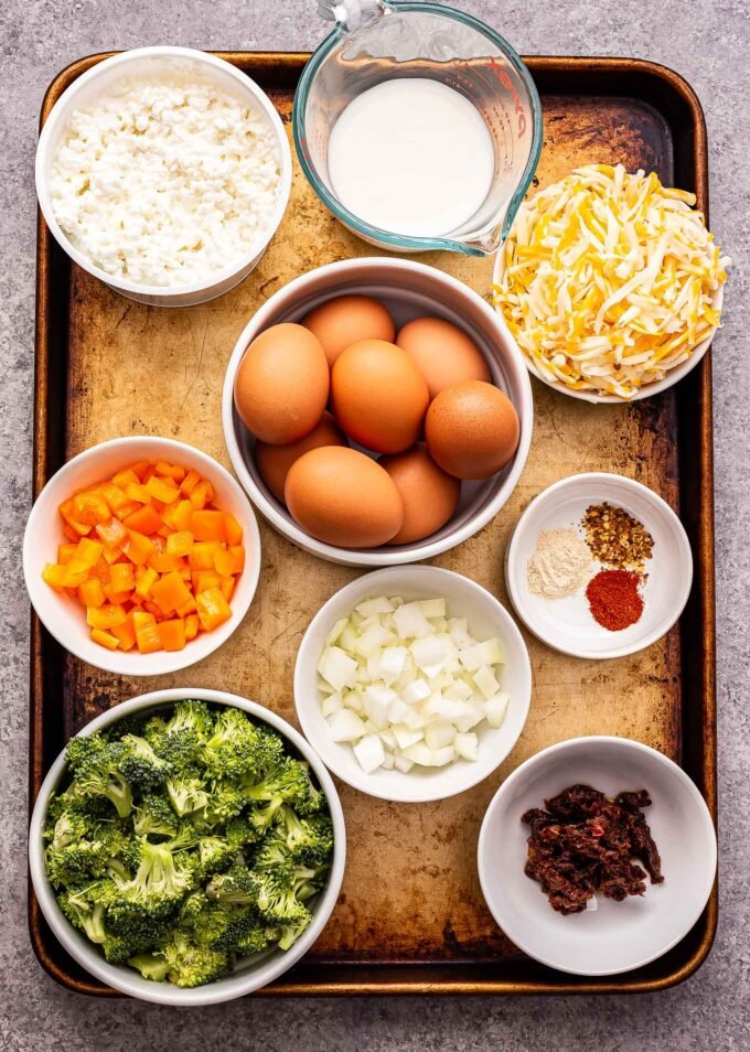 ingredients used to make Crustless Vegetable Quiche on a sheet pan.