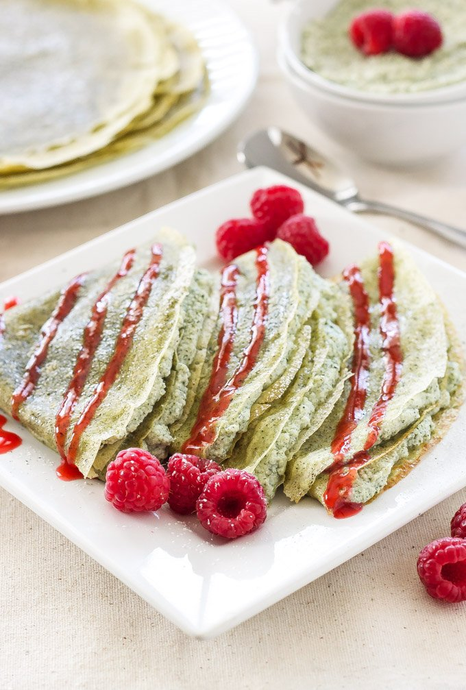 Green Tea Crepes with Matcha Ricotta Filling & Raspberry Sauce | Green tea lovers these crepes are the perfect treat for you!