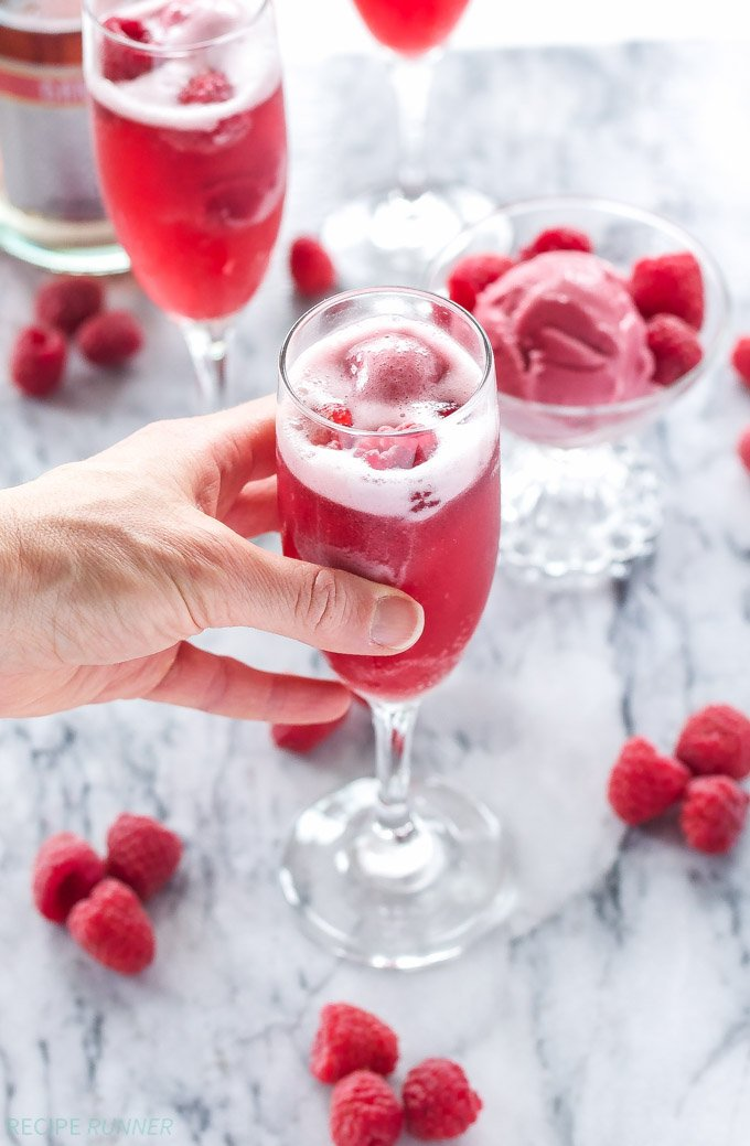 Raspberry Sorbet Bellinis | 3 ingredients is all you need to make these pretty and delicious cocktails!