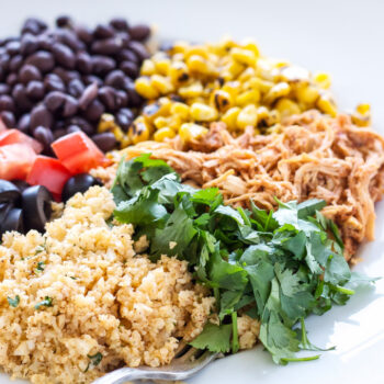 Chicken Enchilada Cauliflower Rice Bowls   This easy to make chicken enchilada bowl recipe uses cauliflower in place of rice for a healthy and delicious dinner!