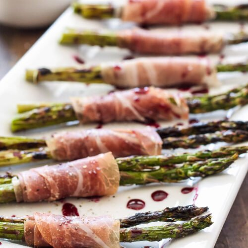 Prosciutto Wrapped Grilled Asparagus with Red Wine Drizzle   Grilled Asparagus wrapped in prosciutto is the perfect summer appetizer!