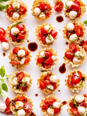 white plate with 15 Mini Caprese Cups on it.