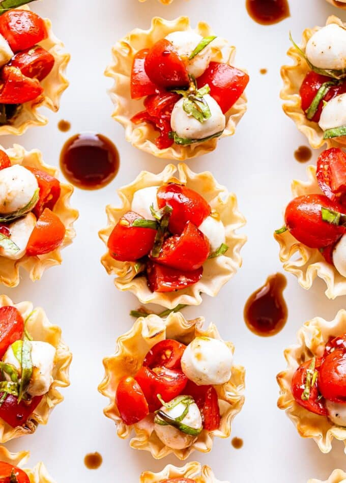 Mini Caprese Cups in phyllo shells drizzled with balsamic glaze.