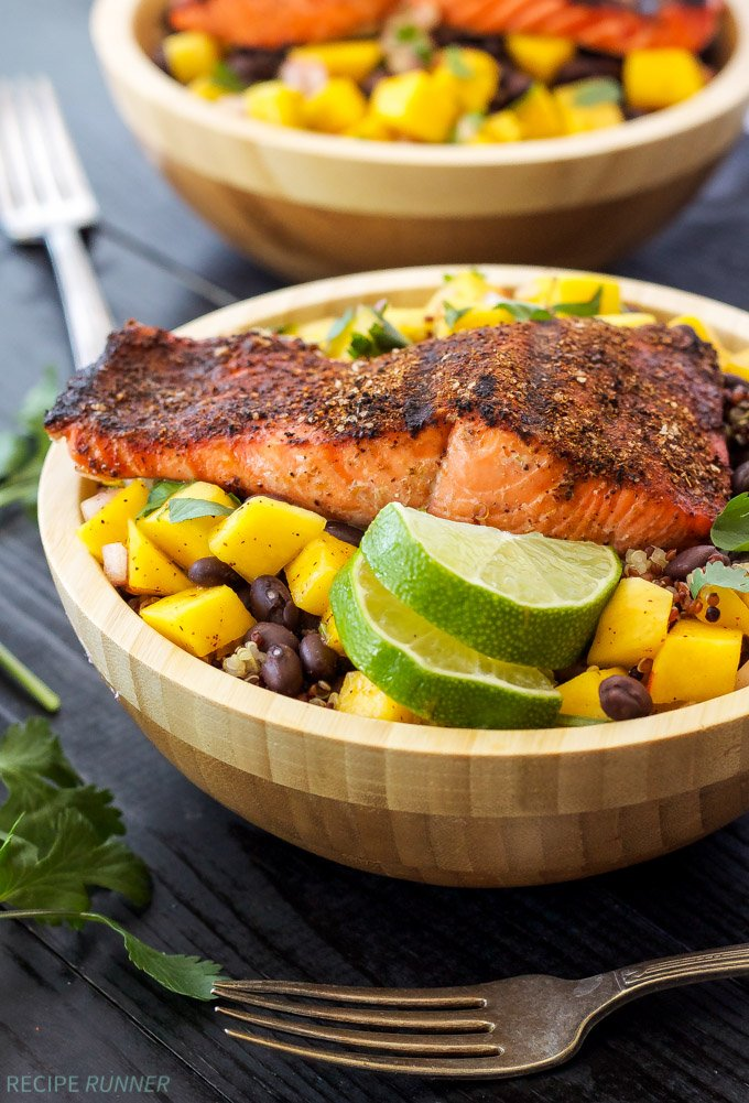 Caribbean Salmon Quinoa Bowls | Caribbean spice rubbed salmon on top of quinoa, black beans, and fresh mango salsa!