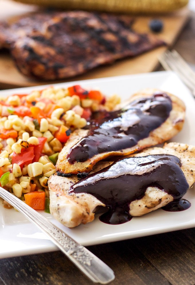 Grilled Chicken with Blueberry Barbecue Sauce and Corn Salsa | Blueberries add a fruity twist to this delicious BBQ sauce! Paired with grilled chicken & corn salsa for the perfect summer meal! #EatTheRainbow