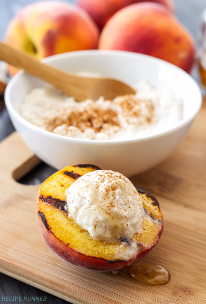 Grilled Peach with Cinnamon Honey Ricotta with a bowl of the ricotta topping behind it.