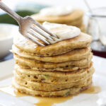 Zucchini Bread Pancakes with Maple Cream Cheese Topping   Whole wheat pancakes loaded with zucchini and topped with delicious maple cream cheese!