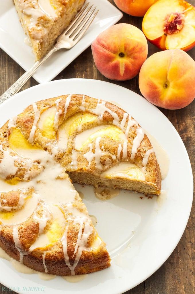 Cinnamon Peach Yogurt Cake   Moist, lightened up cinnamon cake full of fresh peaches and topped with vanilla bean glaze!