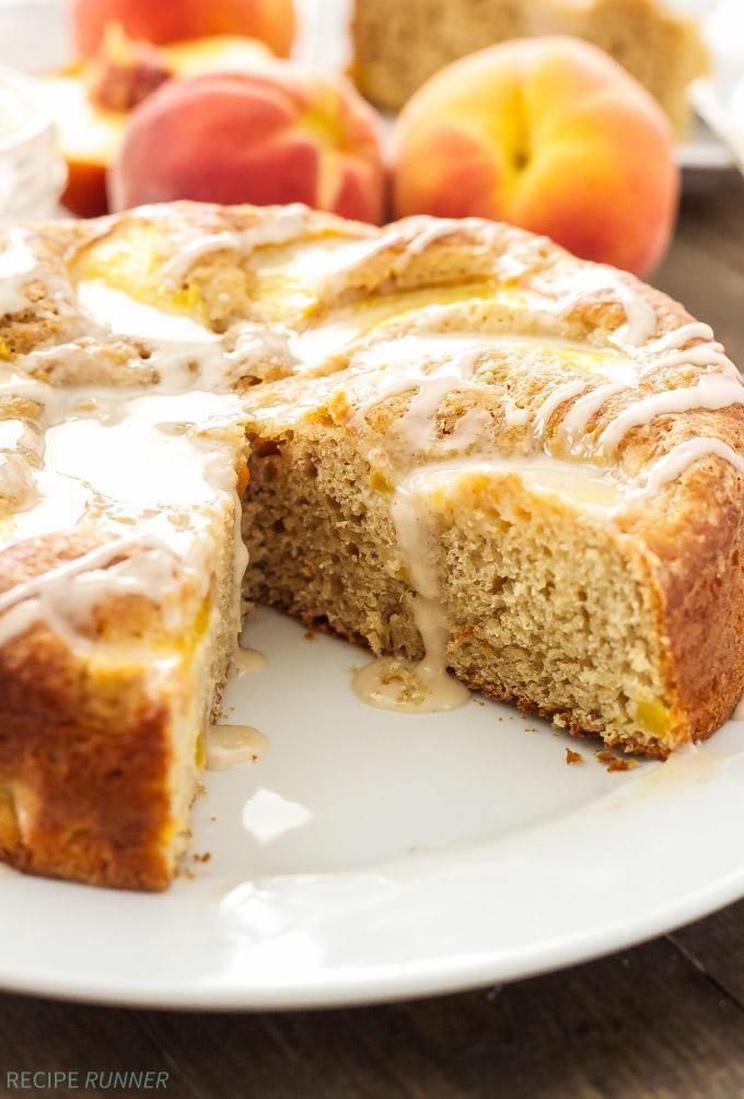 Cinnamon Peach Yogurt Cake | Moist, lightened up cinnamon cake full of fresh peaches and topped with vanilla bean glaze!