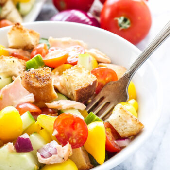 Salmon Panzanella Salad | Tomatoes, cucumbers, crusty bread, and grilled salmon make this panzanella the perfect summer salad!