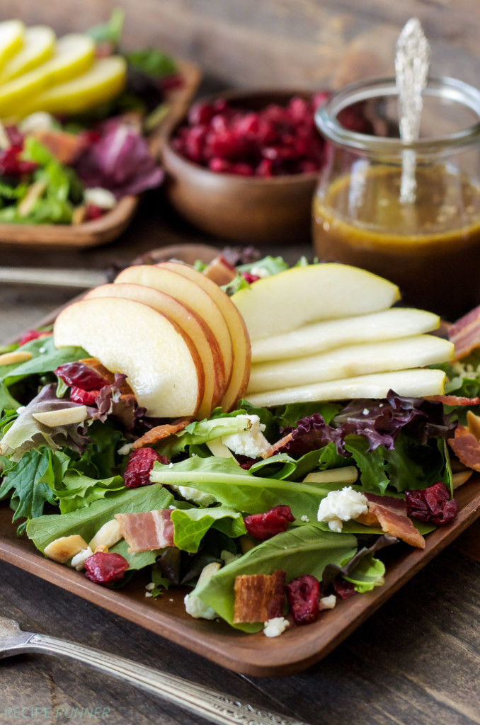 Apple and Pear Salad on top of mixed greens with bacon and dried cranberries.