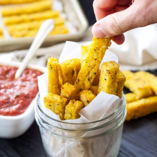 Baked Polenta Fries with Spicy Marinara Sauce   Crispy baked polenta fries with spicy marinara sauce are my favorite dairy-free, meatless appetizer! #ad #MeatlessMondayNight