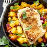 Coconut Almond Crusted Cod with Pineapple Peach Salsa | This paleo and gluten-free coconut almond crusted cod is perfect served with fresh pineapple peach salsa!