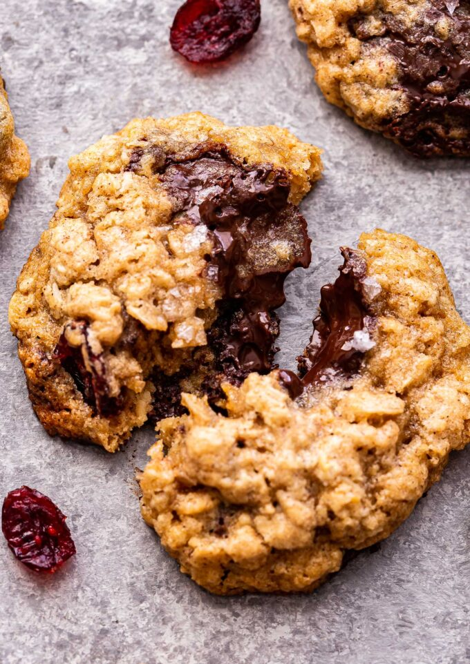 Closeup photo of an Oatmeal Dark Chocolate Cranberry Cookie broken in half.