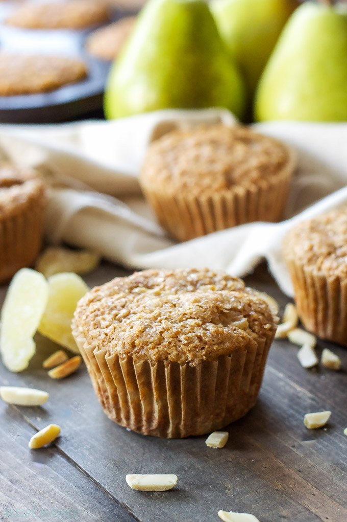 Pear Ginger Muffins | Whole grain muffins filled with pears, almonds, and little bits of candied ginger!