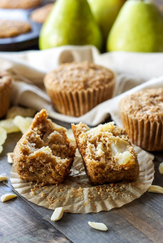 Pear Ginger Muffins   Whole grain muffins filled with pears, almonds, and little bits of candied ginger!