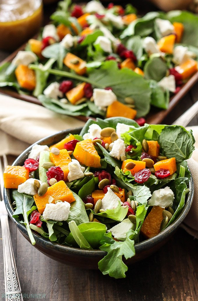 Roasted Butternut Squash Salad with Cider Vinaigrette   Baby kale topped with roasted butternut squash, dried cranberries, pepitas, and goat cheese is the perfect fall salad!