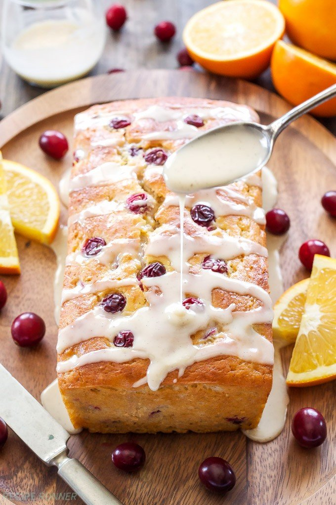 Cranberry Orange Yogurt Cake | This holiday flavored cranberry orange yogurt cake with vanilla orange glaze will be a gorgeous addition to your brunch or dessert table!
