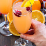 Cranberry Orange Mimosas   Add a little cranberry simple syrup to these traditional mimosas for a festive holiday drink, perfect for brunch!