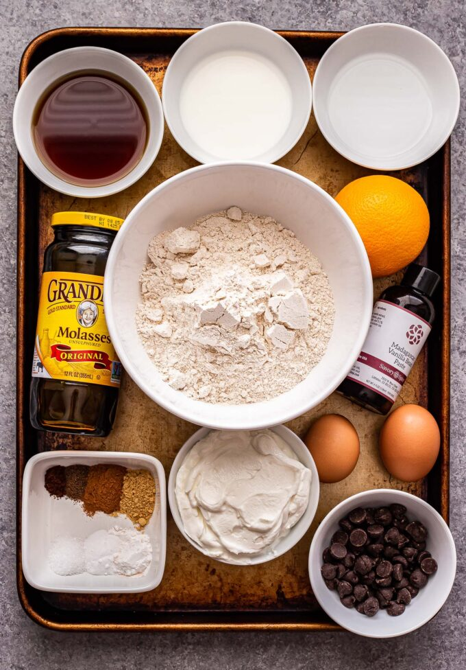 Ingredients used to make the Gingerbread Chocolate Chip Muffins on a sheet pan.