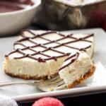 Vanilla Bean Cheesecake Bars with Chocolate Ganache | These lightened up vanilla cheesecake bars are the perfect holiday treat!
