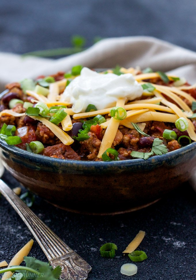 Healthy Slow Cooker Turkey Chili | Low on fat and calories and high on flavor, this Healthy Slow Cooker Chili will become a family favorite!
