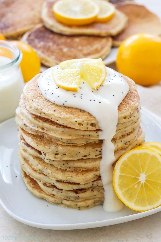 Meyer Lemon Poppy Seed Pancakes   Light, fluffy, lemony pancakes drizzled with a delicious Meyer lemon Greek yogurt sauce! Perfect for breakfast or brunch!