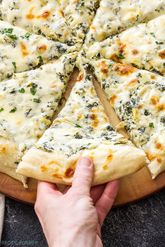Spinach and Artichoke Dip Pizza   Get your appetizer and dinner all in one when you make this Spinach and Artichoke Dip Pizza!