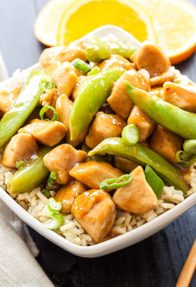 Healthier Orange Chicken | Quick stir-fried chicken tossed together with sweet, crunchy sugar snap peas and a light orange sauce made with fresh orange juice and sweetened with honey!
