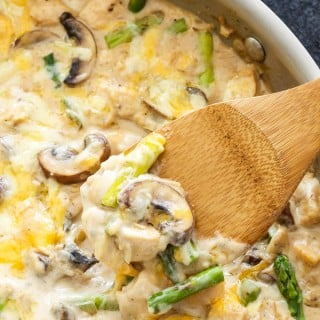 One Pot Creamy Chicken and Asparagus Casserole | An easy one pot, lightened up comfort meal, full of chicken, asparagus, mushrooms and cheese!